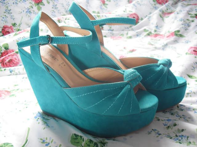 I won: Turquoise Wedges.. ♥