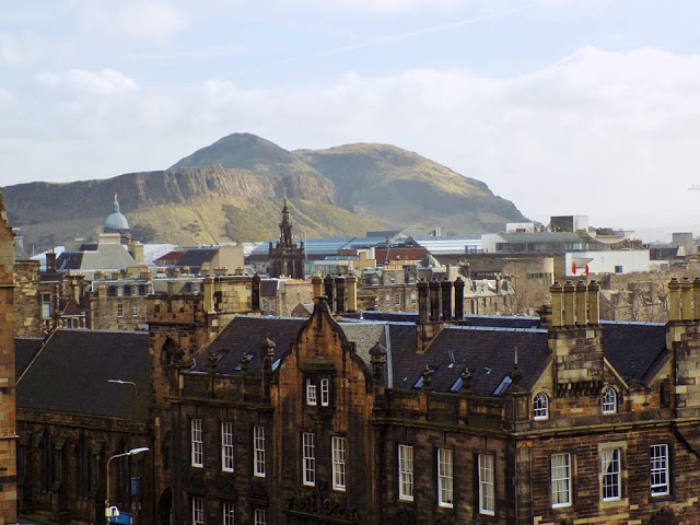 Edinburgh city centre view over mountains and city