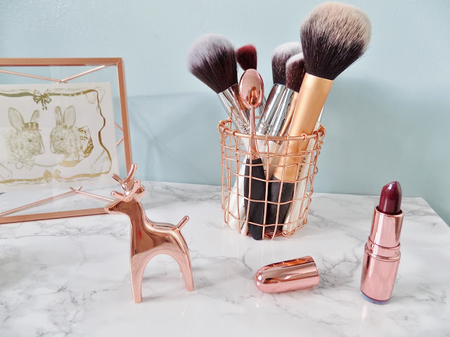Copper Homeware accessories make up brush pot with marble background